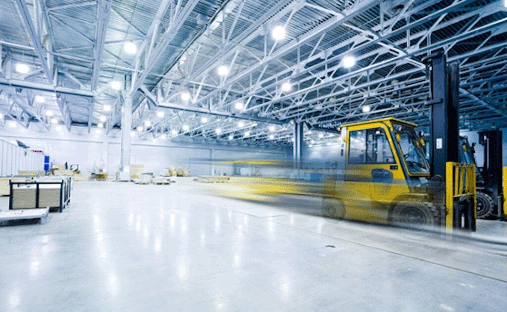 forklift moving fast through warehouse